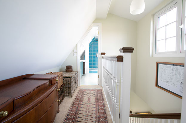 The long hallway is filled with light and is large enough for additional storage.