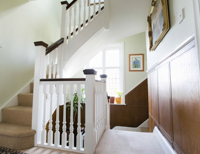 A custom built staircase that blends perfectly with the original features of the house.