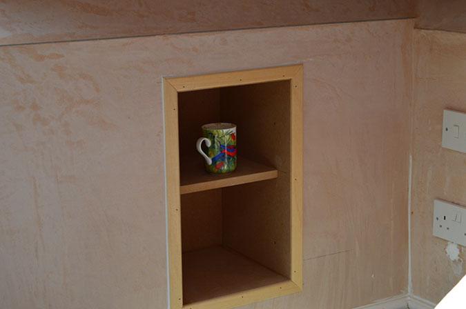 Display shelving set into the wall