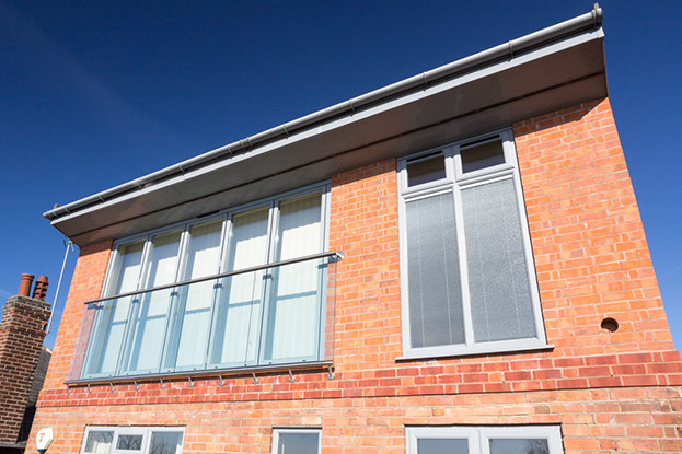 The glass balcony ensures everyone's safety when the bi fold doors are opened